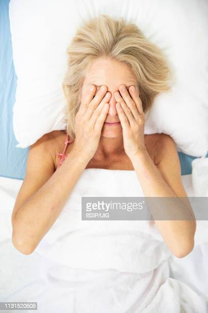 woman and sleep. - inconvenience stock pictures, royalty-free photos & images