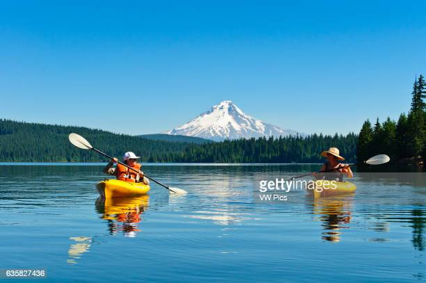 Woman and son kayaking at Timothy Lake Mount Hood National Forest Oregon