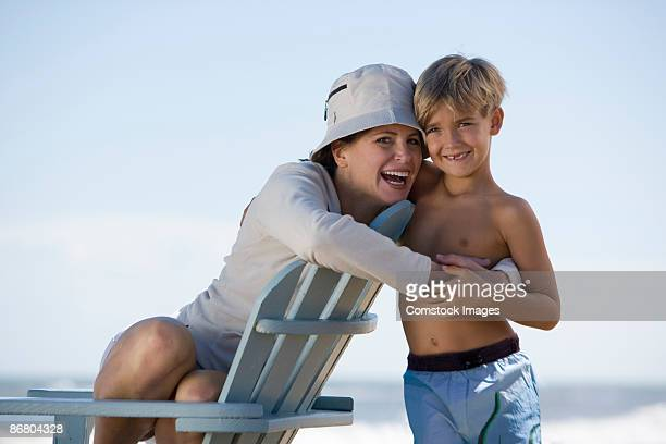 Woman and son on a beach
