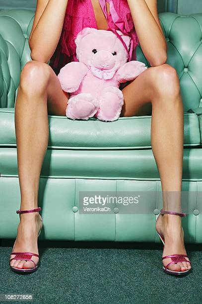 woman and teddy bear - hands in her pants stock photos and pictures
