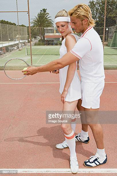 Woman and tennis coach