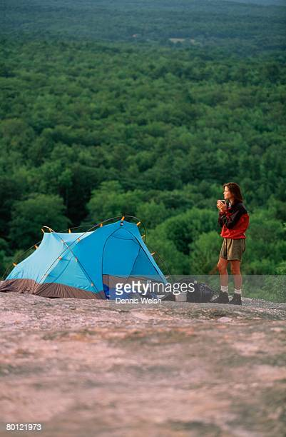 Woman and tent at campsite