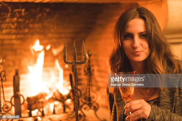 woman and the fireplace - hell stock pictures, royalty-free photos & images