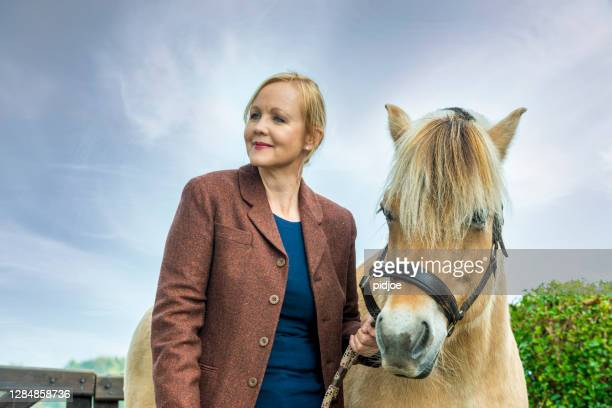 woman and the love for her horse, filly - riding stock pictures, royalty-free photos & images