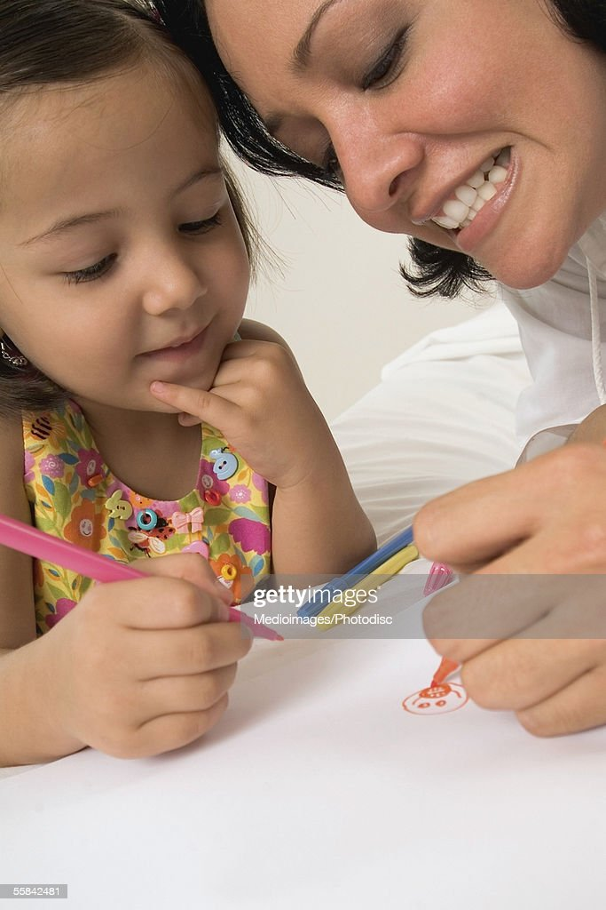Woman And Three Year Old Girl Coloring With Markers Closeup Tilt ...