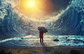 Woman and tidal wave