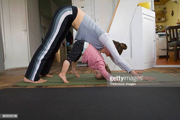 Woman and toddler doing yoga