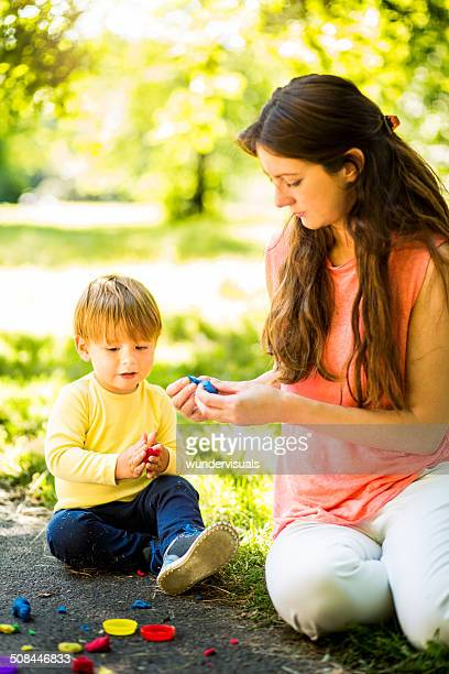 Woman and Toddler Using Play Dough