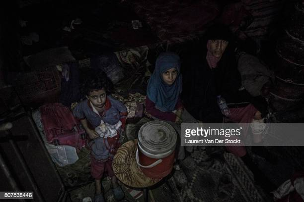 A woman and two children are discovered by Iraqi forces in basement of alNuri mosque complex on June 29 2017 The Iraqi Army Special Operations Forces...