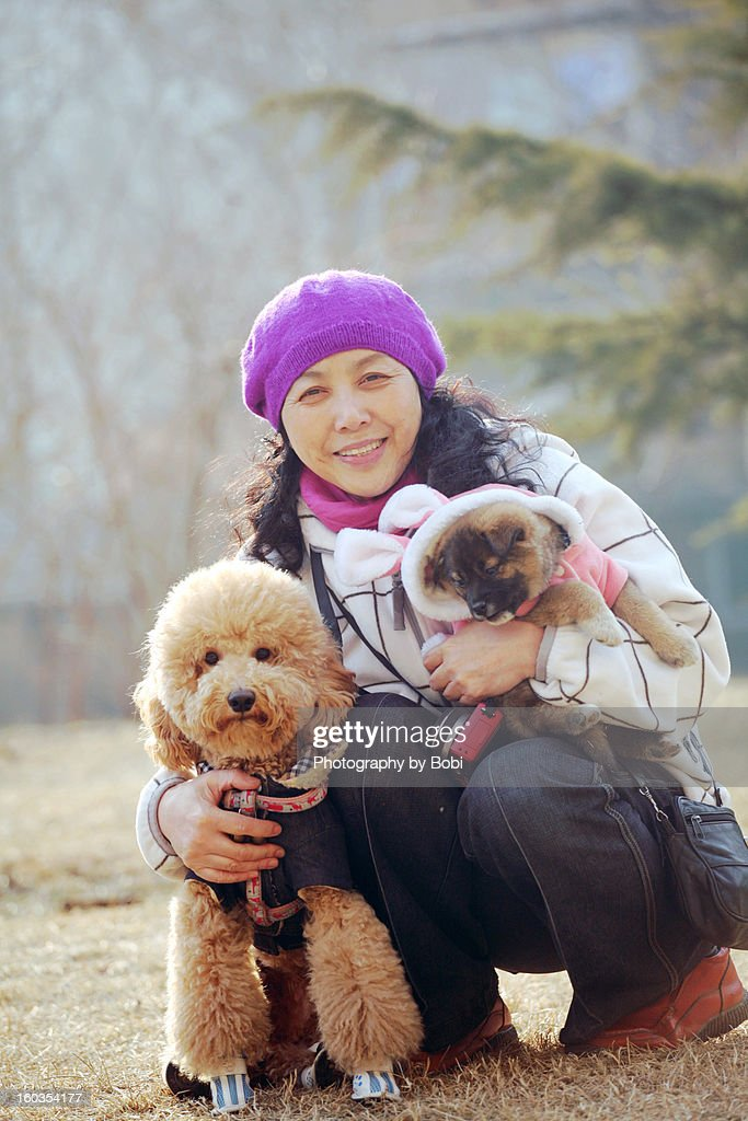 Woman and two dogs : Stock Photo