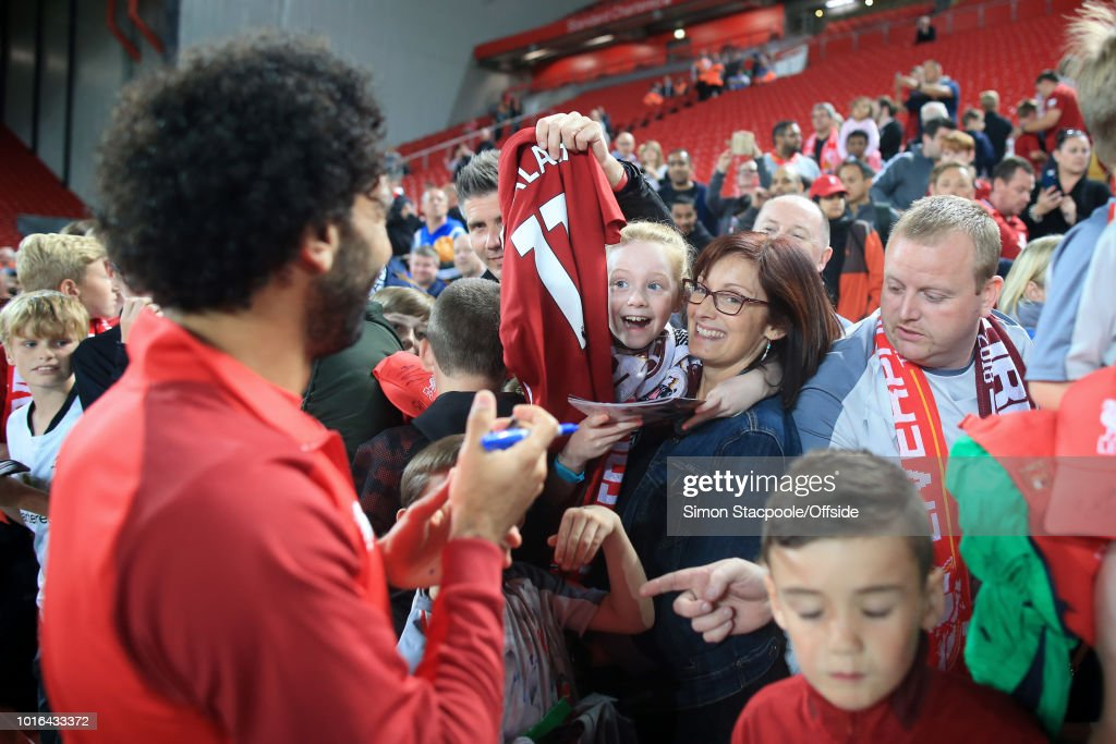 A woman and young girl react after getting an autograph from Mohamed Salah of Liverpool after the pre-season friendly match between Liverpool and Torino at Anfield on August 7, 2018 in Liverpool, England.