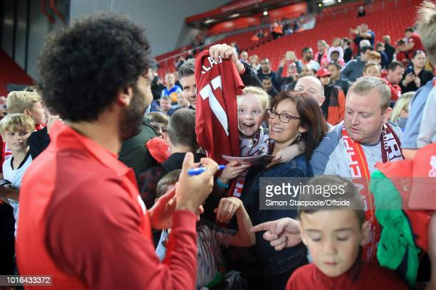 A woman and young girl react after getting an autograph from Mohamed Salah of Liverpool after the preseason friendly match between Liverpool and...