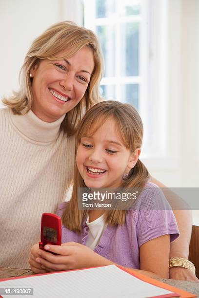Woman and young girl with her mobile phone