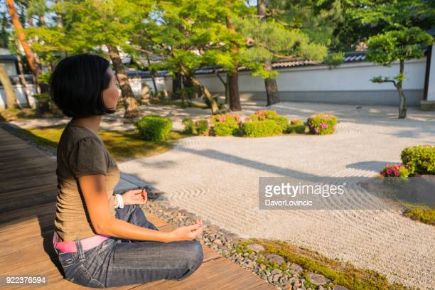 Woman and Zen garden  of Chion-ji temple in Kyoto, Japan
