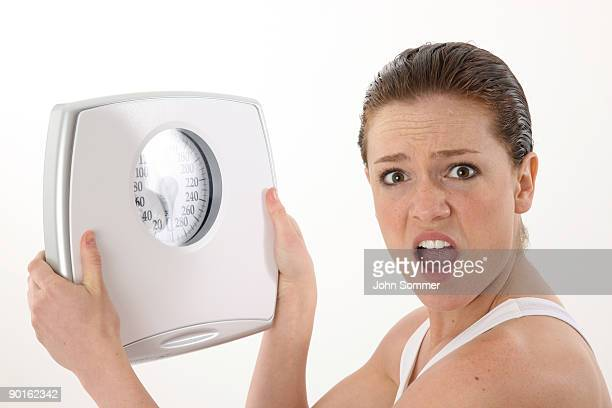 Woman angry at scale