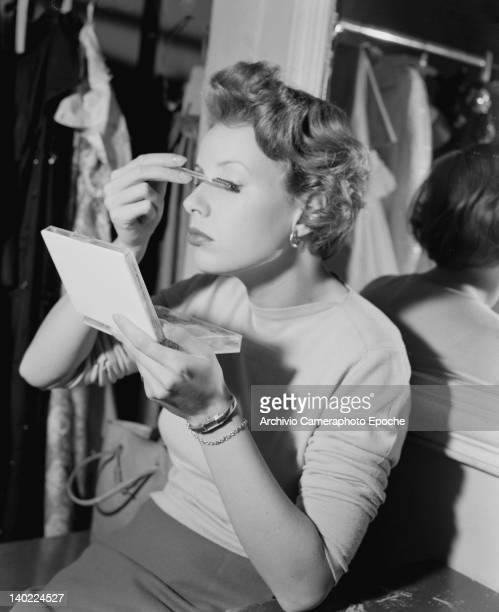 A woman applies her makeup in Milan 25th October 1949 This photograph is either of or by photographer Sigrid von Schweinitz aka Sisi