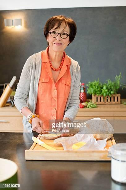 Woman applying butter on bread