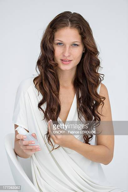 woman applying conditioner in her hair - hair conditioner stock photos and pictures