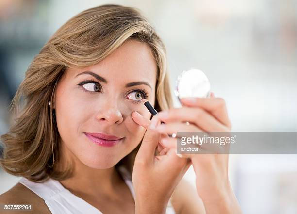 woman applying eyeliner - makeup concepts - eye liner stock photos and pictures