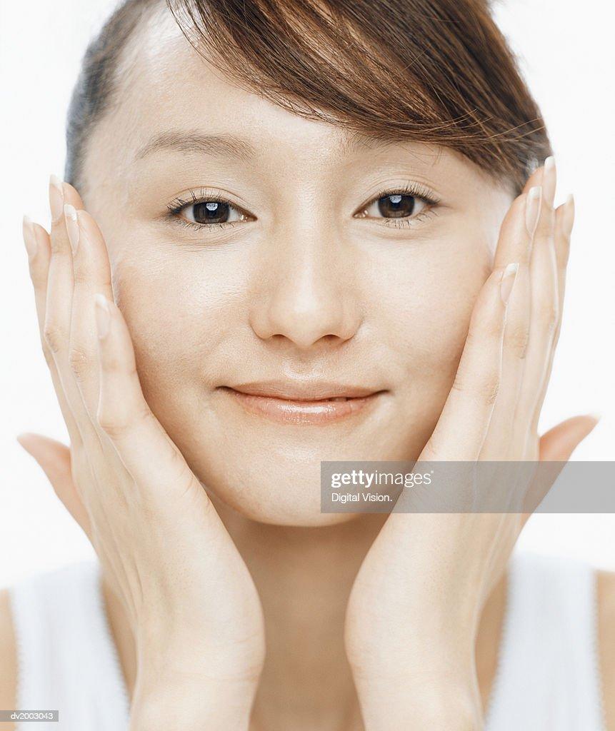 Woman Applying Facial Cream : Stock Photo