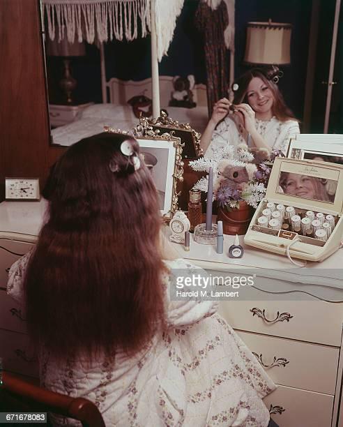 Woman Applying Hair Curlers