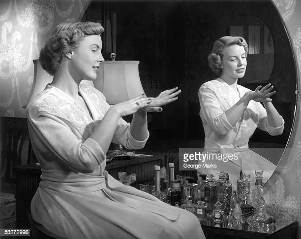 Woman applying hand lotion