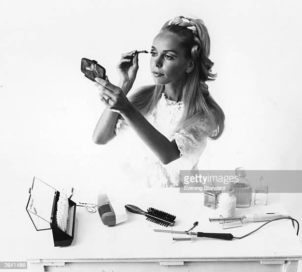 A woman applying her makeup