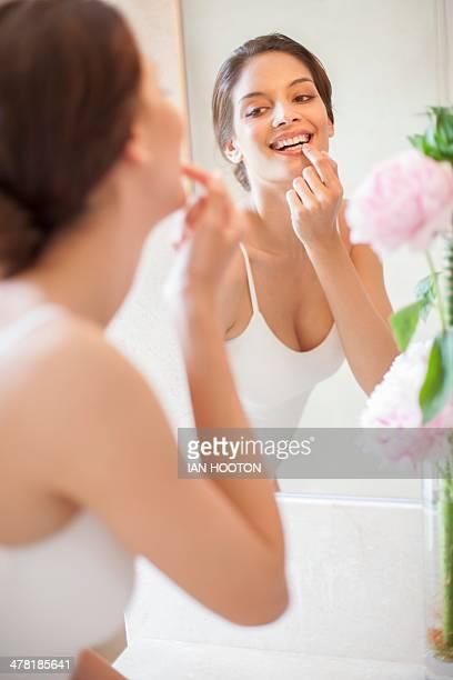 Woman applying lip balm