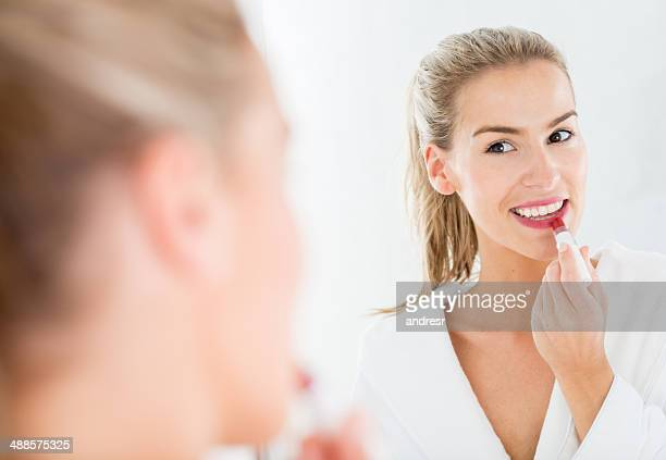 woman applying lipstick - lip balm stock pictures, royalty-free photos & images