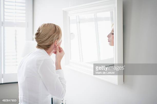 Woman applying make-up, Breda, Brabant, Netherlands