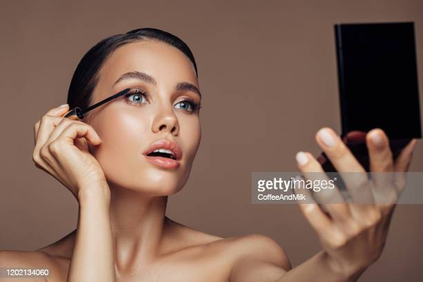 woman applying make-up - mascara stock pictures, royalty-free photos & images
