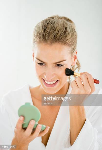 woman applying makeup - powder compact stock pictures, royalty-free photos & images