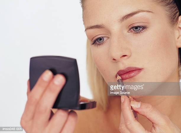 Woman Auftragen von make-up