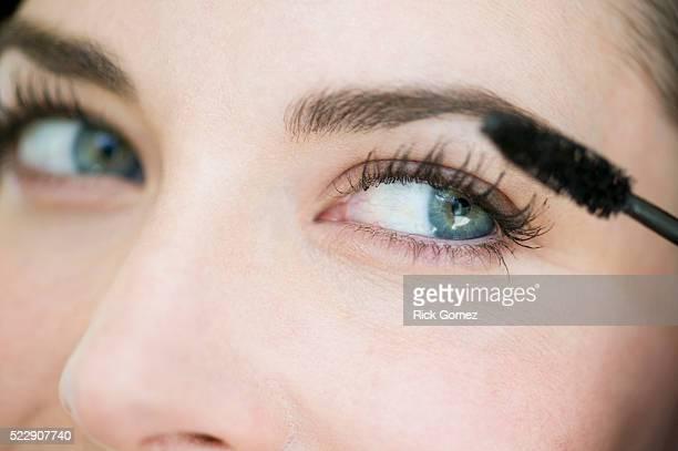 woman applying mascara - mascara stock pictures, royalty-free photos & images