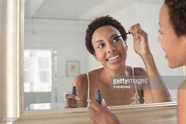 woman applying mascara - mascara stock pictures, royalty-free photos & images