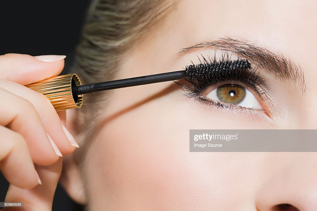 Woman applying mascara : Stock Photo