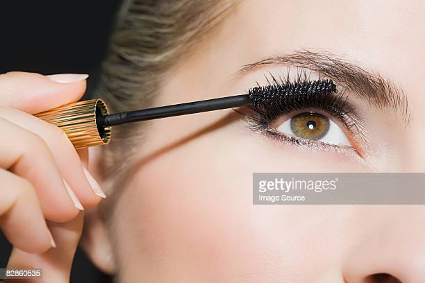 woman applying mascara - eye make up stock photos and pictures