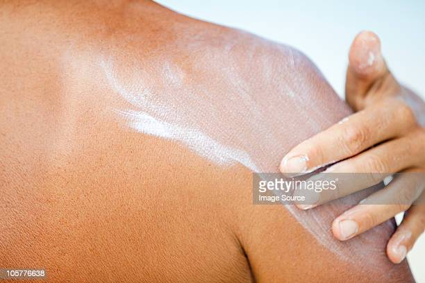 woman applying sunscreen, maldives - sunscreen stock photos and pictures