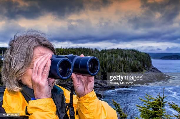 Woman appreciating nature through binoculars