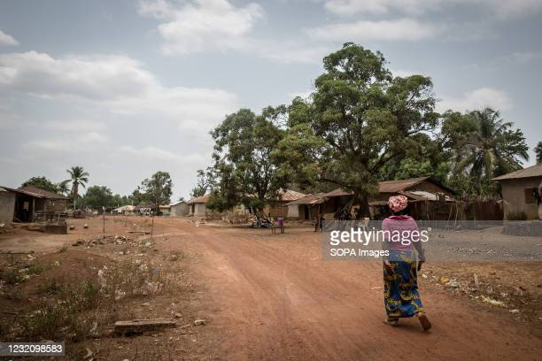 Woman approaches a community-manned checkpoint in Mafaray, close to Sierra Leone's border with Guinea. The latest Ebola outbreak in Guinea was...