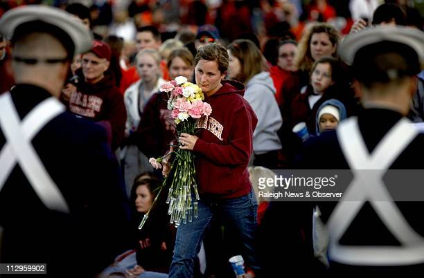 A woman approaches a memorial on the campus of Virginia Tech before a vigil on Tuesday April 17 2007 Thousands of students and members of the...