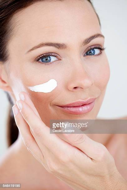 Woman appying face cream