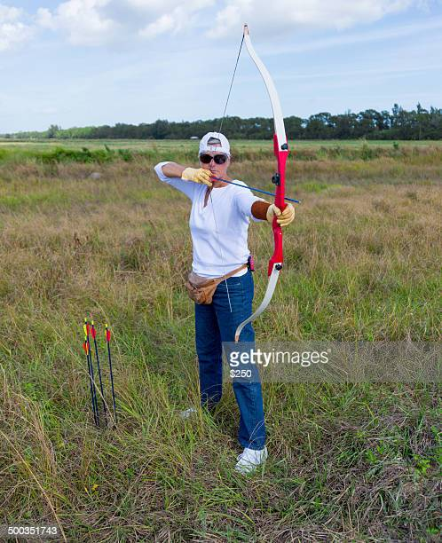 woman archer - vero beach stock pictures, royalty-free photos & images