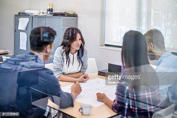 Woman architects leading a meeting at the office