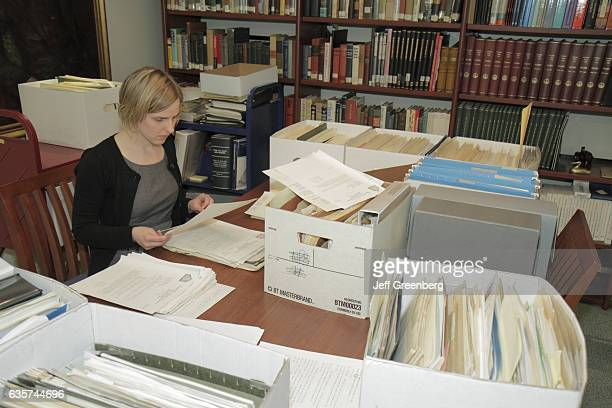 A woman archivist intern in the National Journalism Library