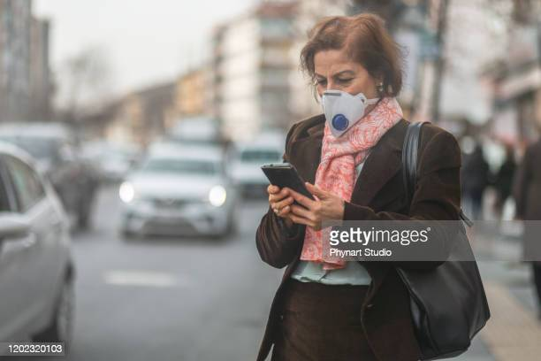 woman are going to work.she wears n95 mask.prevent pm2.5 dust and smog she shares the power of dust in a social network - scuba mask stock pictures, royalty-free photos & images