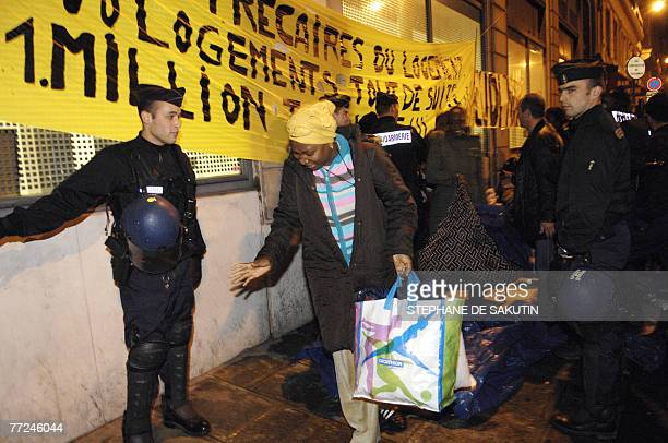 A woman argues as policemen evacuate the settlement of homeless people 10 October 2007 rue de la Banque near the Bourse in Paris some days after a...