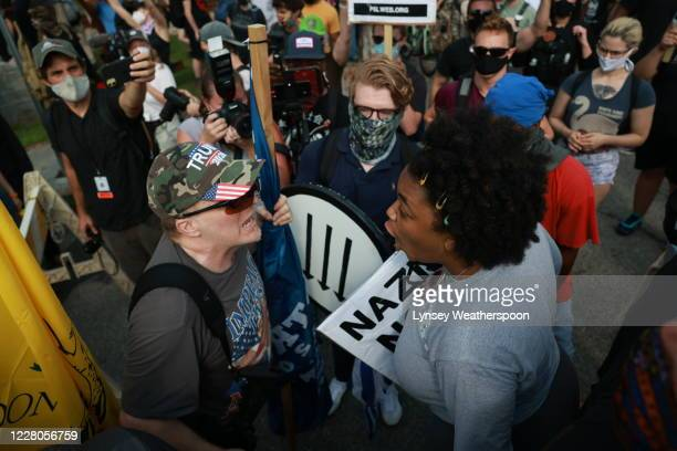 Woman argues with a far-right protester during a rally on August 15, 2020 near the downtown of Stone Mountain, Georgia. Georgia's Stone Mountain Park...