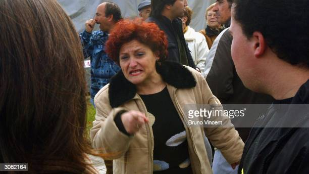 A woman argues with a passerby at El Pozo train station March 13 2004 in Madrid Spain Madrid was devastated by a bomb blast during the morning rush...