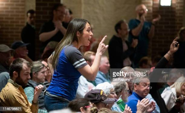 A woman argues with US Rep Justin Amash at a Town Hall Meeting he held on May 28 2019 in Grand Rapids Michigan Amash was the first Republican member...